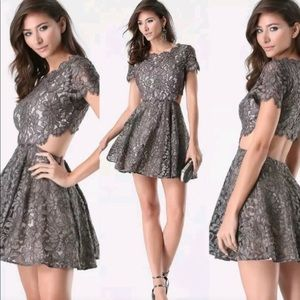 bebe Dresses - Bebe holiday lace cut out dress